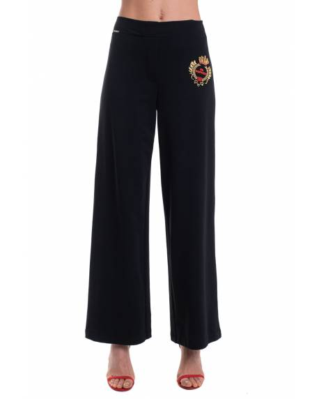 TROUSERS WITH DECORATIVE PRESS BUTTONS ON THE SIDES 11XPT919